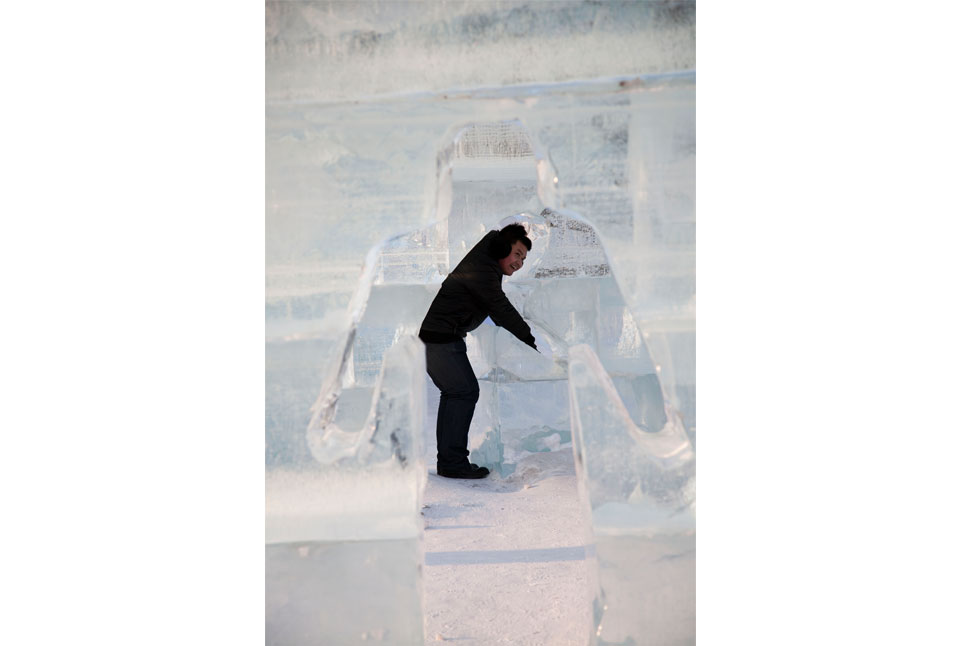 A man is seen through an ice silhouette. Altogether, the ice festival costs around 6 million RMB ($909,000) to stage.        Jonathan Browning