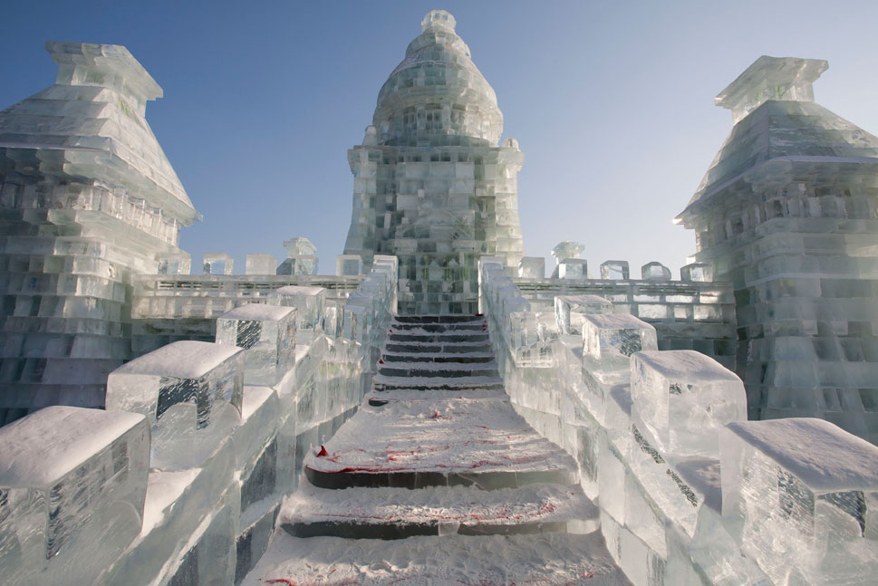 Icy stairs lead up to a turret on one of the massive ice castles.   The festival construction, which takes place on an area known as Sun Island, requires over six million cubic feet of ice.