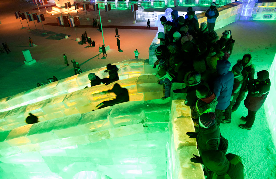 Visitors enjoy an ice luge inside the complex.