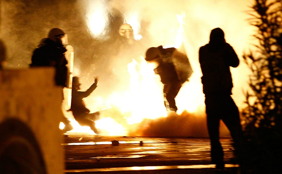 Demonstrators clash with police during the demonstration  against the new austerity measures in Syntagma Square on Feb. 12.       Vladimir Rys/Getty Images