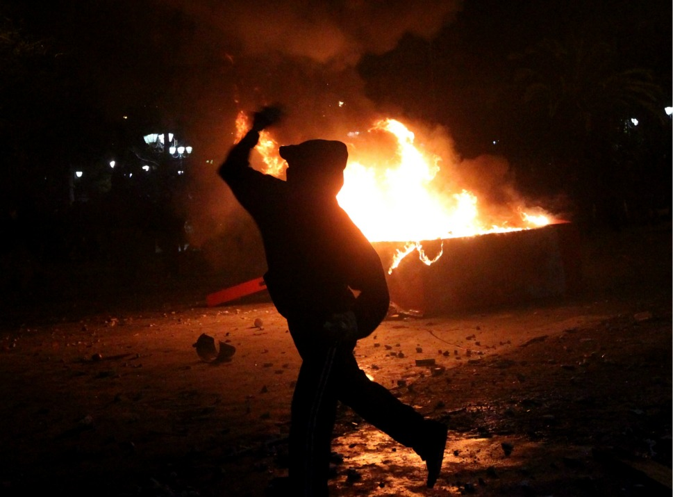 Protesters  clash with riot police outside of the Greek Parliament in Athens on Feb. 12. Some 170 people were reported injured and 70 were arrested during the clashes.