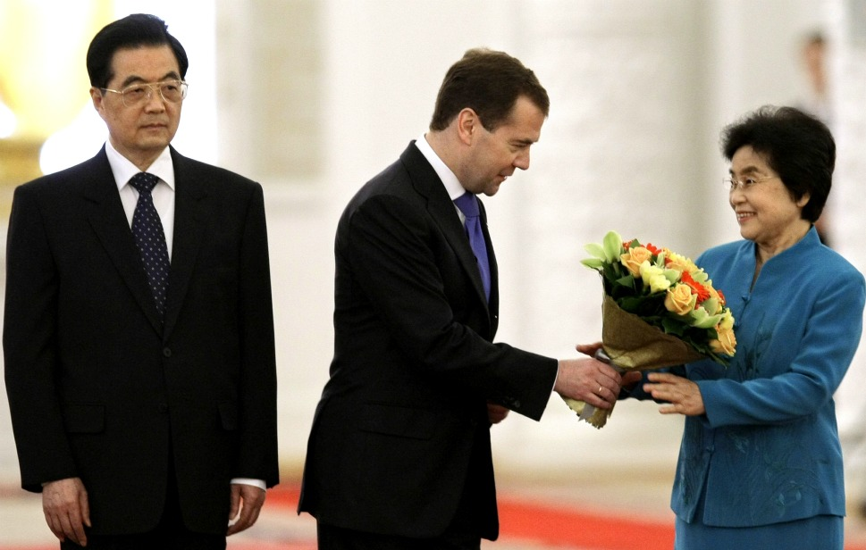 "The couple: Chinese President Hu Jintao and his wife, Liu  Yongqing.      Love lesson: Small gestures matter.       Above, President Hu Jintao looks on as Russian  President Dmitry Medvedev presents flowers to Hu's wife, Liu Yongqing,  during a welcome ceremony at the Kremlin on June 16, 2011. Hu may appear stone-faced, but we detect a flicker in his eye that says, ""One more word to  my wife, and you'll be facing your own reset."" Hu met his wife when they were  both students at Beijing's Tsinghua University. Liu has accompanied her reserved husband on  official trips all over the world, and while there may not be many pictures of them snogging, we'd like to think their globetrotting is a sign of how much  they enjoy each others' company."