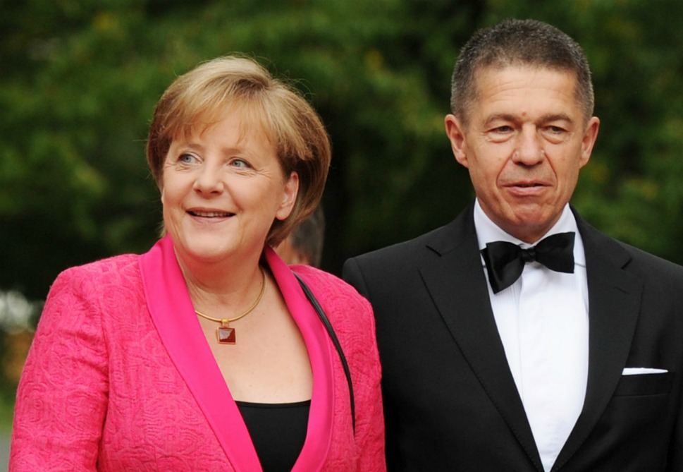 "The couple: German  Chancellor Angela Merkel and her husband, Joachim Sauer.      Love lesson: Quiet love burns as brightly as showy  romance.       Chancellor Angela Merkel has a reputation as a  straight-laced realist, but behind every great woman is a great  quantum chemistry researcher. Here, Merkel  and husband Joachim Sauer arrive on the red carpet ahead  of the opening performance of Tannhaeuser  at the 100th edition of the Wagner opera festival in Germany on  July 25, 2011. Sauer, whose name means ""sour,"" or ""grumpy""  in German, is so publicity-shy he didn't  even attend  Merkel's inauguration in 2005. He spent the ceremony holed away in his  chemistry lab in Berlin, although he swears he watched it on television. But  Merkel and Sauer are used to doing things their own way. It's the second  marriage for both of them: They met when they both worked at the Academy of  Sciences in the 1980s, and although they lived together for many years, they  didn't marry until 1998, when Merkel was warned that her career might be  jeopardized if she didn't get hitched."