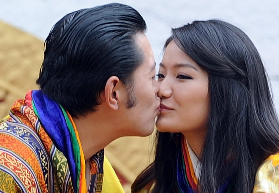 The couple: Bhutanese King Jigme Khesar Namgyel  Wangchuck and  Queen Jetsun Pema.      Love lesson: Love knows no boundaries.        King Jigme Khesar Namgyel Wangchuck kisses Queen  Jetsun Pema during a ceremony at the main stadium in Thimphu in Bhutan on Oct. 15,  2011. Bhutan's newly married 31-year-old king and his 21-year-old bride greeted  huge crowds of well-wishers on Oct. 14 as they made their way on foot back to  the capital along windy Himalayan roads. The hugely popular king married and crowned Jetsun Pema, the commoner daughter of an  airline pilot, reviving the Cinderella fantasies of Himalayan women everywhere.