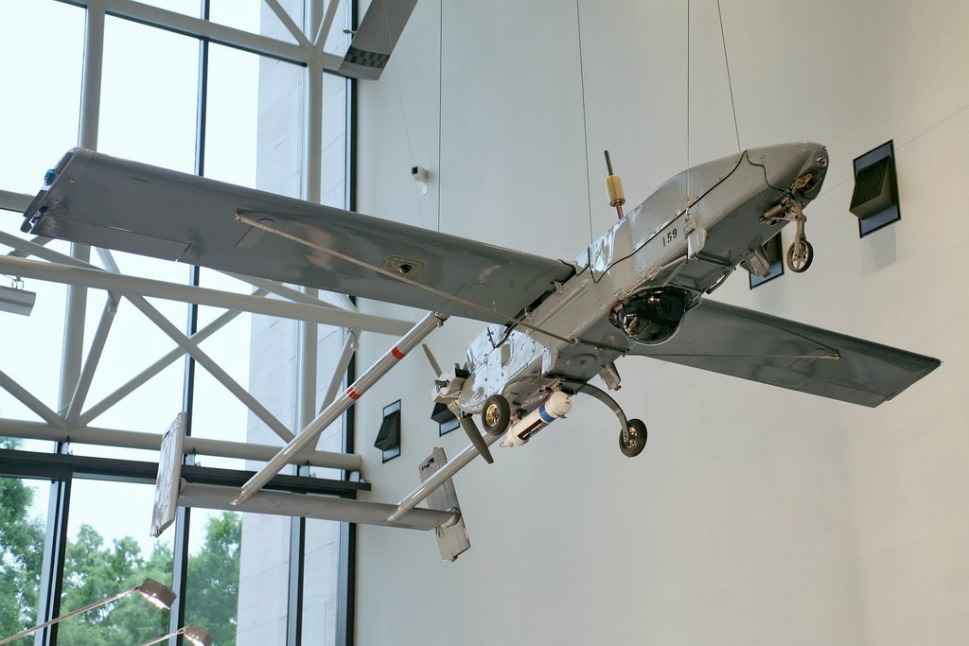 """1986:  The Pioneer RQ-2A          First launched in December 1986, the Pioneer UAV system -- which gives the tactical commander images of a specific target or battleground image in real time -- performs a wide variety of """"reconnaissance, surveillance and target acquisition"""" tasks, according to the U.S. Navy. It was first used in the late 1980s when military operations in Grenada, Lebanon, and Libya required a system of unmanned targeting at a low cost. The Pioneer, still in use today, is launched by a rocket-assisted takeoff, weighs 416 pounds, and travels at over 109 miles per hour. It can float, and can be recovered from sea landings."""