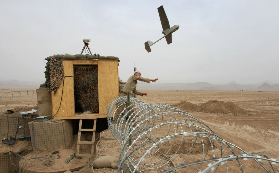 U.S. Marine Sgt. Nicholas  Bender launches a Raven surveillance drone near the remote Afghan village of  Baqwa on March 21, 2009. Marines from the 3rd Battalion, 8th Marine Regiment  use the unmanned aerial vehicles to get real-time intelligence on Taliban  movements.
