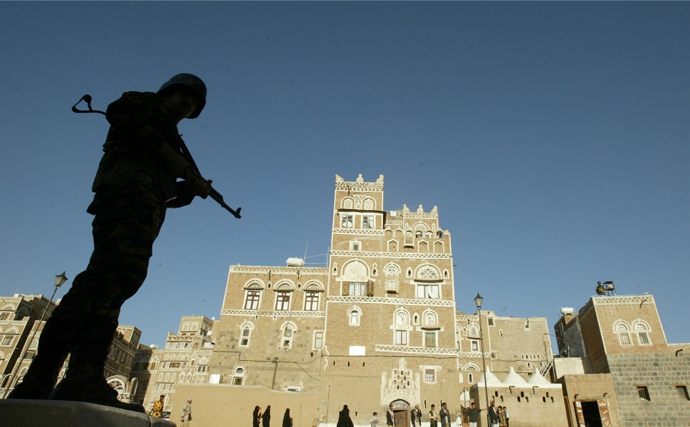 A Yemeni soldier stands guard  in old Sanaa. The United States and Britain temporarily closed their embassies  in the Yemeni capital on Jan. 3, 2010, after threats from AQAP and the failed  bombing of a U.S. airliner on Dec. 25, 2009, by a terrorist trained in Yemen.      PATRICK BAZ/AFP/Getty Images
