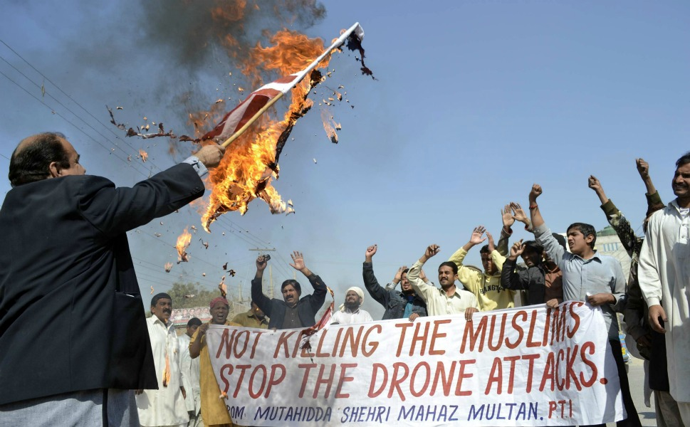 Unsurprisingly, Pakistanis  aren't happy about the drones. Above, a protester burns an American flag as a  crowd shouts slogans during a protest against the drone attacks in the city of Multan  on Feb. 9, 2011. A 2011 Pew Research Center poll found that a paltry 12 percent of  Pakistanis had a favorable view of the United States, and 69 percent saw the  United States as more enemy than friend.      But they're effective. According  to New American Foundation data, U.S. drone strikes have killed more than 1,000  militants in Pakistan since Obama's inauguration.