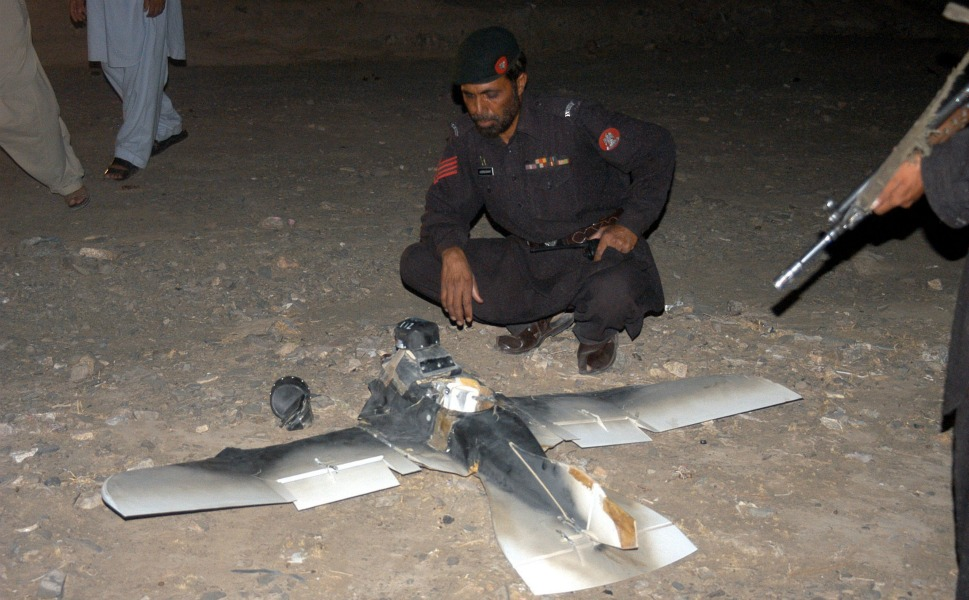 """PAKISTAN      Obama has authorized 244 drone strikes in Pakistan since his inauguration in 2009, according to data compiled by the New America Foundation -- a number that dwarfs  the strikes conducted under President George  W. Bush. On Jan. 31, Obama publicly  confirmed for the first time that the United States was  conducting these strikes, describing it as """"a targeted,  focused effort at people who are on a list of  active terrorists who are trying to go in and harm  Americans.""""      However, it's not clear that's the entire story. A report by the London-based Bureau of Investigative Journalism found that hundreds of civilians have been """"credibly reported""""  killed in U.S. drone  attacks, including more than 60  children. U.S. officials argue that this number is much too high, though they do admit  that dozens of civilians have been inadvertently killed during operations.      Whatever the risks, it's clear the Obama  administration is doubling down on the use of special forces to fight its wars.  Even in this age of budget-cutting, the Pentagon's new budget seeks  to add 3,000 people to SOCOM -- while the rest of the  military shrinks.      Above, Pakistani security  personnel examine a crashed American surveillance drone in the town of Chaman  on Aug. 25, 2011. The drone crashed in southwestern Pakistan near a  paramilitary base close to the Afghan border."""