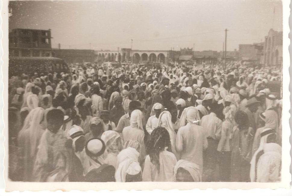 Above, people throng a central square in crowded Kuwait City. At this time, Kuwait was mostly comprised of Kuwait City, with another portion of the population still living a nomadic lifestyle in the surrounding desert areas.