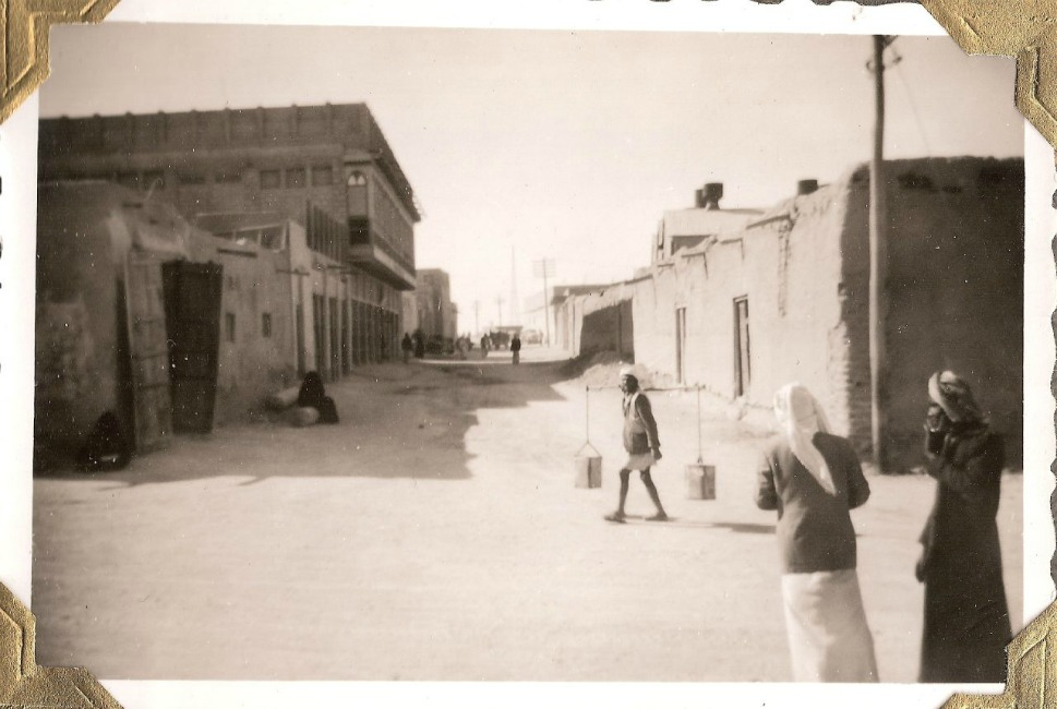 A man carries water in Kuwait City in 1950.