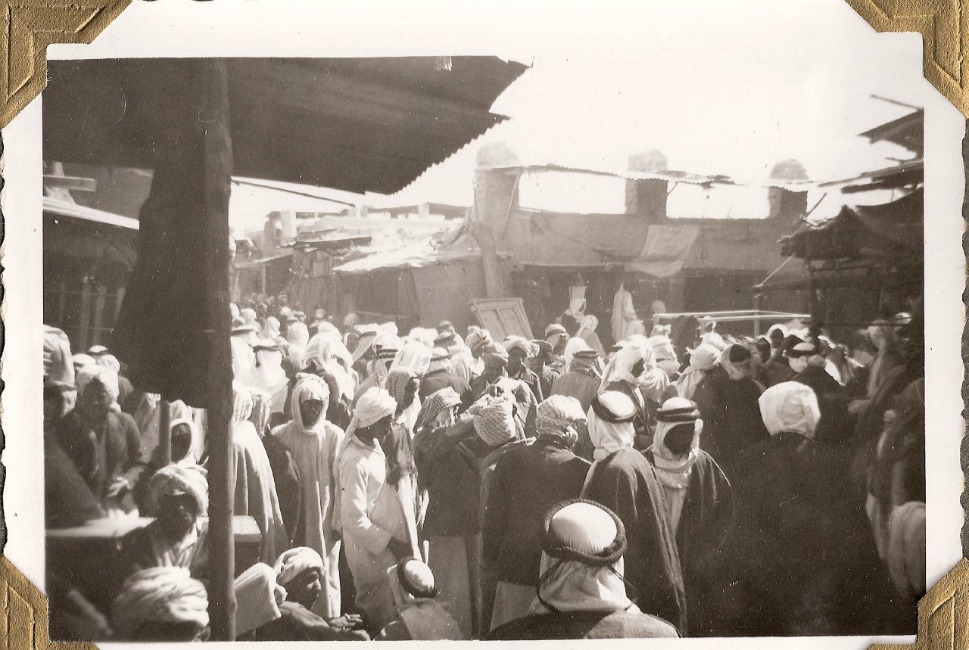 """Above, a busy scene in the market in Kuwait City in 1950. The buildings shown here are made of mud with palm fronds; Diwan notes that all such buildings were destroyed in Kuwait during the push toward modernization. """"They flattened the old city. It was part of their plan to erase this old past and to move quickly into development."""""""