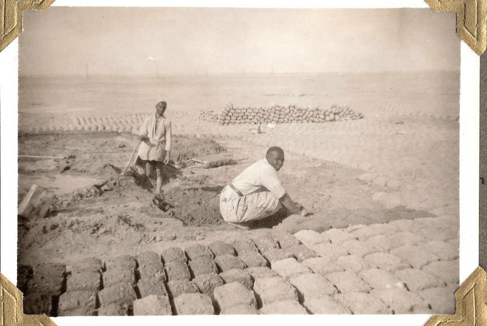 Men make bricks in 1950 using traditional  methods.