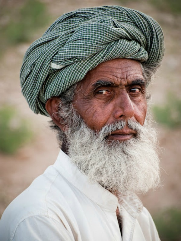 Standing guard: A Baloch chowkedar -- watchman. His job is to guard a well and its  equipment, as well as the water that comes from the well. Much of Baluchistan's  water supply is taken from underground aquifers like this one.