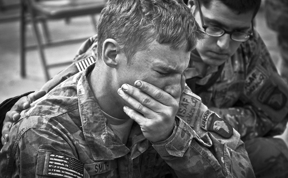 U.S. Army soldiers assigned to Company C, 2nd Battalion, 327th Infantry  Regiment, Task Force No Slack, 1st Brigade Combat Team, 101st Airborne  Division, say farewell during a memorial service for six fallen soldiers at  Forward Operating Base Joyce in eastern Afghanistan's Kunar Province on April  9, 2011.