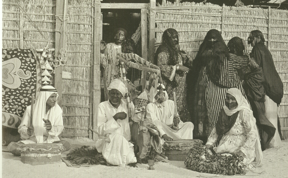 A group of Bedouin play music outside of a house in Dubai.