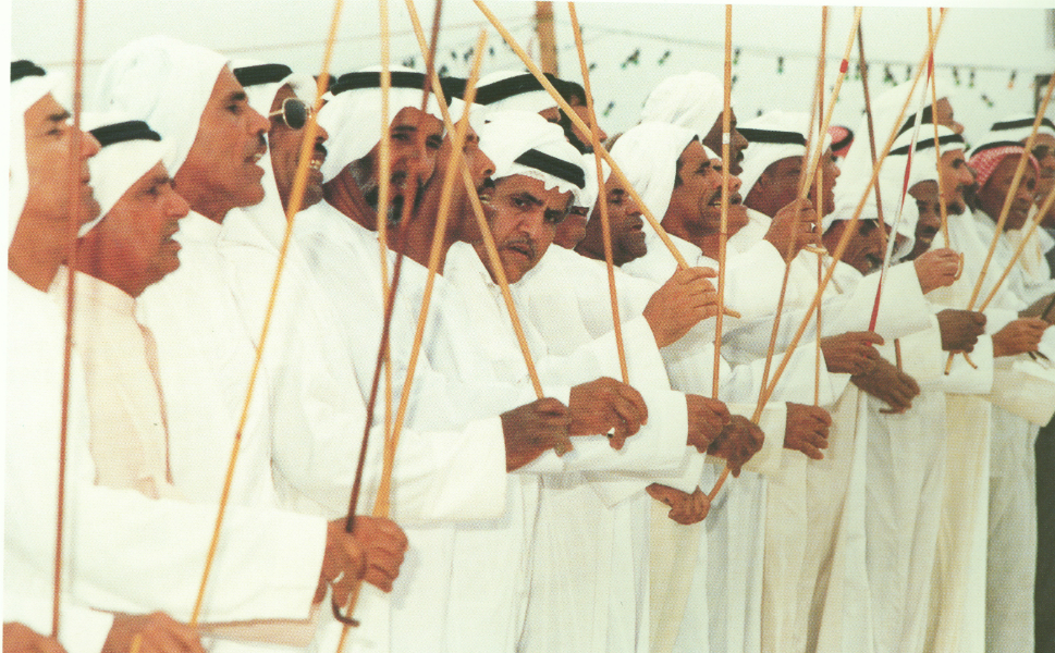 The male section of a wedding party celebrates the nuptials.