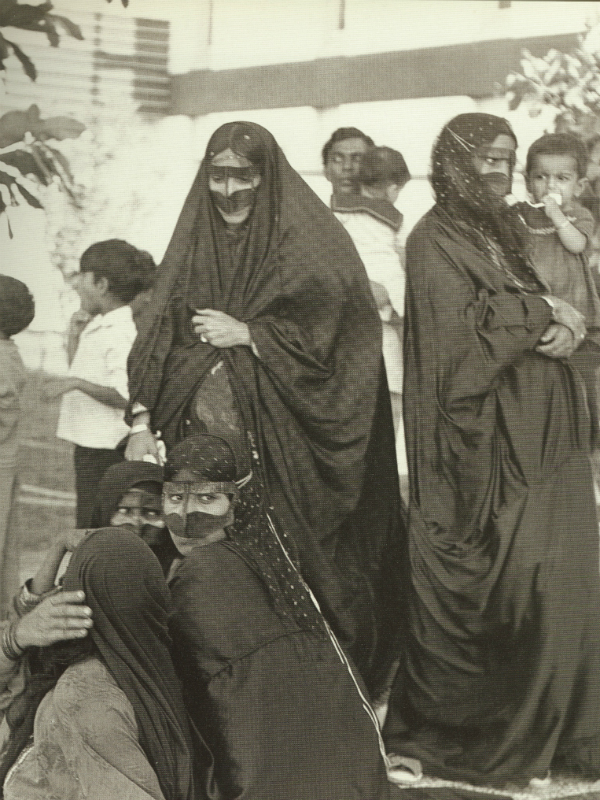 The women of the wedding party, seen wearing traditional veils.