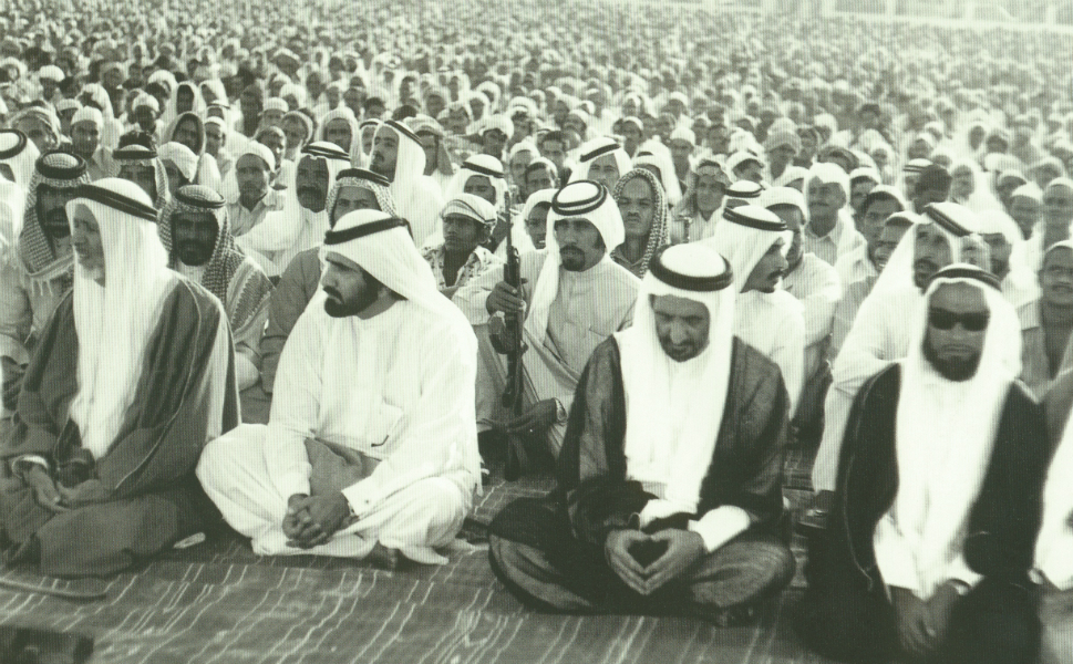 Men recite prayers for the Muslim festival of Eid in Dubai.