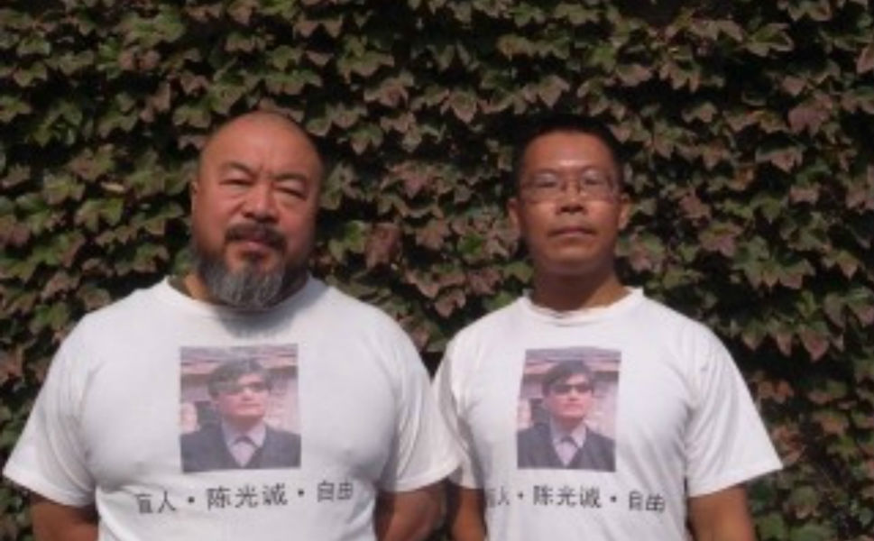 Renowned Chinese artist Ai Weiwei and Chen's lawyer Teng Biao wear T-shirts printed with Chen Guangcheng's photo.