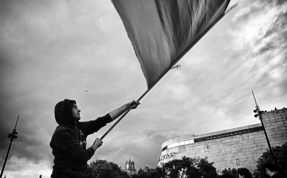 Up to 80 percent of the Spanish population supports the indignados, according to recent polls. Above, a protester waves the Spanish flag in Plaza Catalunya, Barcelona, at the  end of the parade on May 12. The event marked the beginning the occupation of the square.