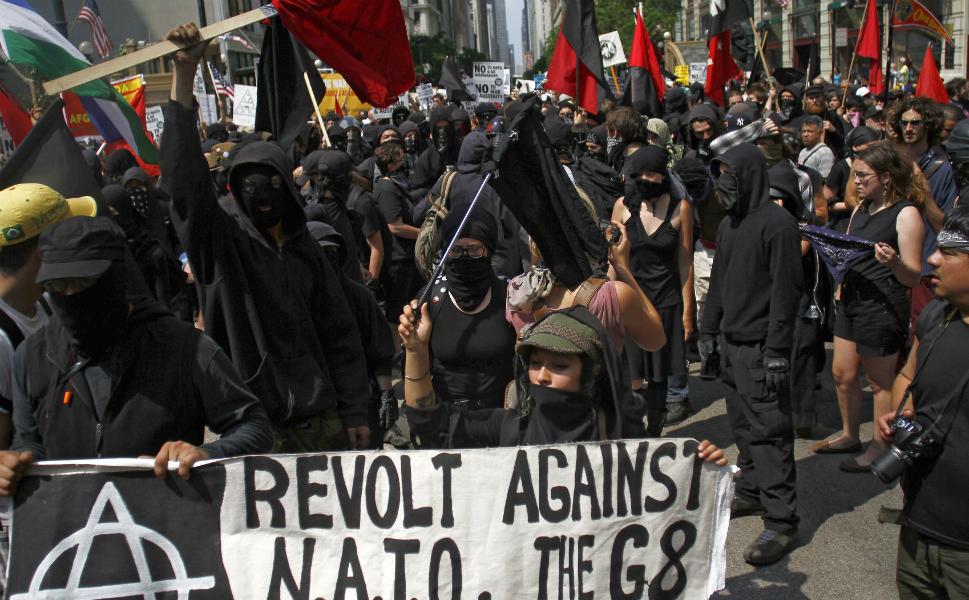 "Anarchist demonstrators, dressed in all black, protested during the first day of the Chicago  NATO summit. While there were some scuffles with police, the protests were mostly peaceful with ""fewer than two dozen"" arrests."