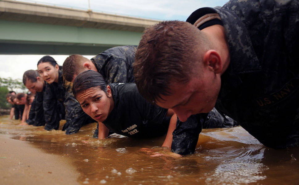 """First-year midshipmen, or plebes, participate in the  """"wet and sandy"""" portion of the U.S. Naval Academy's annual Sea  Trials. The Sea Trials program is modeled after the Marine Corps' Crucible and the Navy's  Battle Stations recruit programs. It is a capstone event for the fourth-class  midshipmen and serves as a leadership challenge for the upper class, who lead  each event during the exercise."""