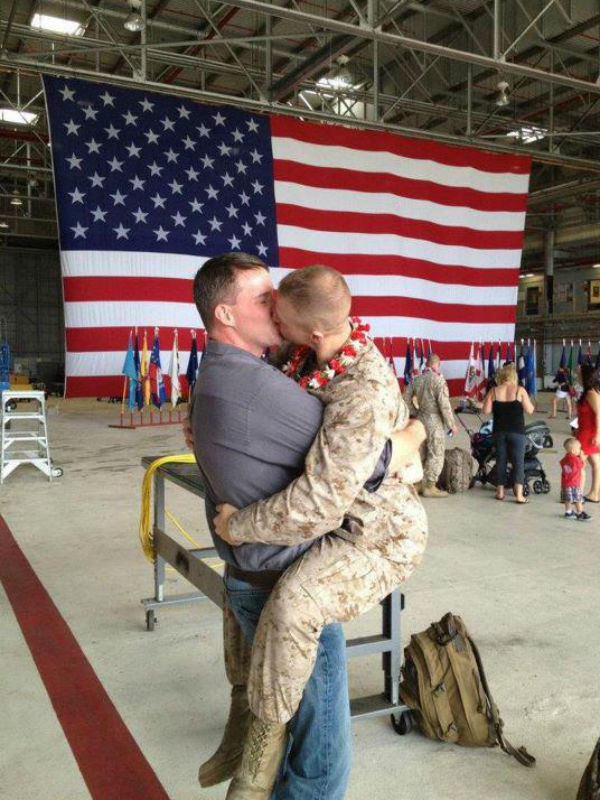 Marine Sgt. Brandon Morgan and his boyfriend embrace in Hawaii during a homecoming ceremony for soldiers returning from Afghanistan. The military's Don'tAsk, Don't tell policy, which barred openly gay people from serving in the military, expired in September 2011.