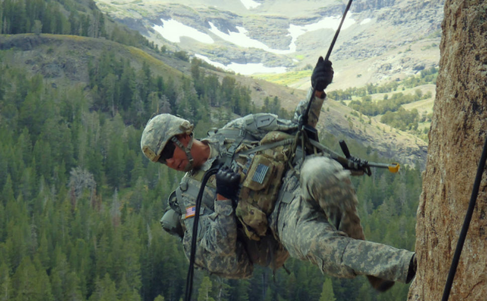 Cpl. Jose Pacheco, a soldier with Headquarters and  Headquarters Platoon, Company D, 1st Battalion, 28th Infantry Regiment, 4th  Infantry Brigade Combat Team, 1st Infantry Division, practices rappelling  techniques during the basic-mobility portion of an exercise at a training center in Northern California's Toiyabe  National Forest.