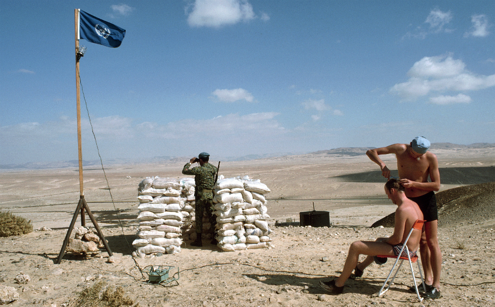 The 1967 war between Israel and its Arab neighbors brought an end to the UNEF peacekeeping mission, as Egypt demanded the withdrawal of U.N. blue helmets. But the United Nations came back in 1973, after Egypt and Syria launched a military strike against Israel on Yom Kippur, triggering the third Arab-Israeli war. The new peacekeeping force, which was authorized to monitor a ceasefire, included many of the traditional Western peacekeepers -- Austria, Canada, Finland, and Sweden -- but it also drew more widely from the developing world, including Ghana, Indonesia, Nepal, and one Warsaw Pact country, Poland.  In this 1975 photo at a UNEF II observation post in the Sinai, a Finnish peacekeeper cuts his countryman's hair while an Indonesian soldier stands sentry.