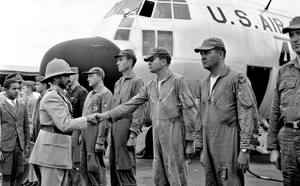 The early United Nations had no planes of its own and relied on the U.S. Air Force to transport its budding international peacekeeping force into action. In this 1960 photograph, Ethiopian Emperor Haile Selassie greets a crew of U.S. Air Force pilots who are preparing to airlift Ethiopian troops to the Congo.