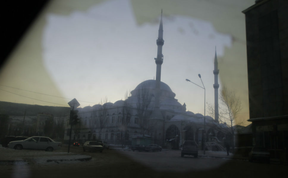 The central mosque in  Makhachkala seen through a car window.