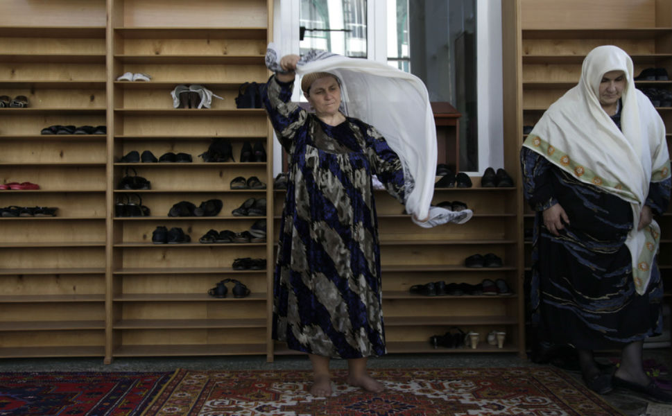 Women remove their shoes  before prayer at the central mosque in Makhachkala.
