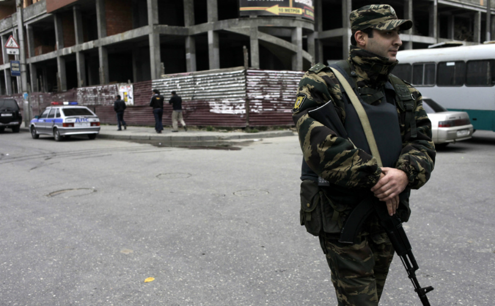 "A member of the Dagestani  security forces stands guard outside a central building in Makhachkala. The shootings of policemen have grown shockingly common: As Nemtsova reports, ""254 Russian police officers died in insurgency-related  incidents last year, far more than the number of U.S. casualties in  Afghanistan."""