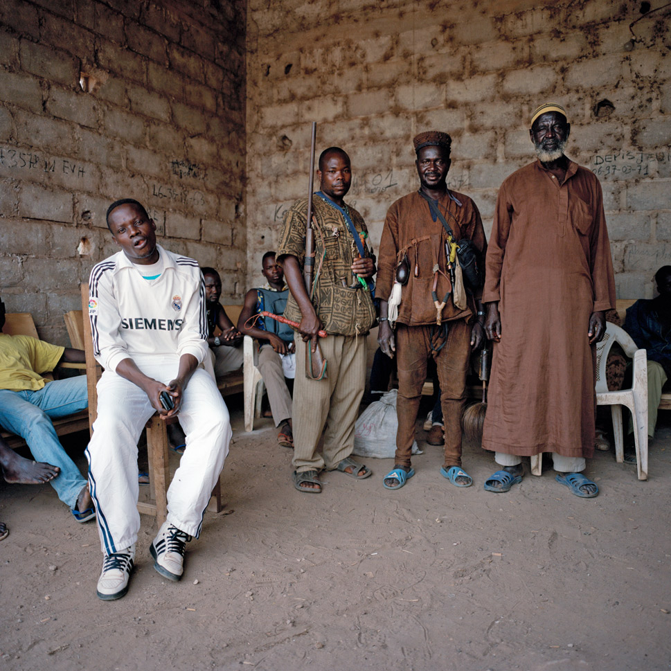 A group of Dozo, or traditional hunters,  pose for a photograph at their encampment in Duekoué on March 12,  2012. The role of the Dozo in last year's post-election violence is unclear;  while many maintain that they are the protectors of the region, Gbagbo supporters insist that the Dozo joined with the advancing  opposition army and participated in heavy fighting and even massacres.