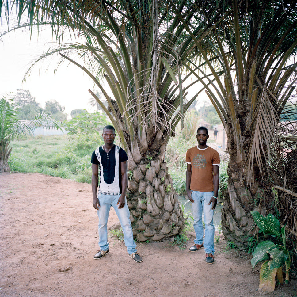 Jean Luc Gnompoa and Olivier Tehe, local villagers, in Duekoue on March 9, 2012. The two were split up during an  attack on their village. Jean Luc  escaped, while Olivier ran straight into a massacre. He survived by running  into a crowd of women and pretending to be one of them so that soldiers  overlooked him. The two are currently living in a refugee camp.