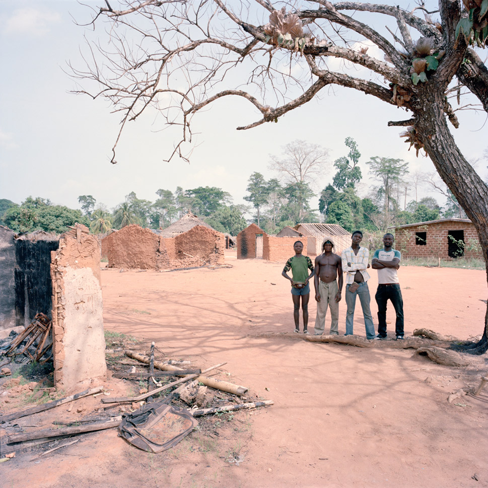 Four local men stand amidst the recent  ruins of Zibablu Yeblu, Ivory Coast on March 8, 2012. While large-scale  fighting has ceased in the country, small attacks are still carried out, a sign  of continued ethnic strife. Zibablu Yeblu was attacked as recently as Feb. 9, 2012. Whether, and when, the violence will end and true reconciliation will begin remains an open question.