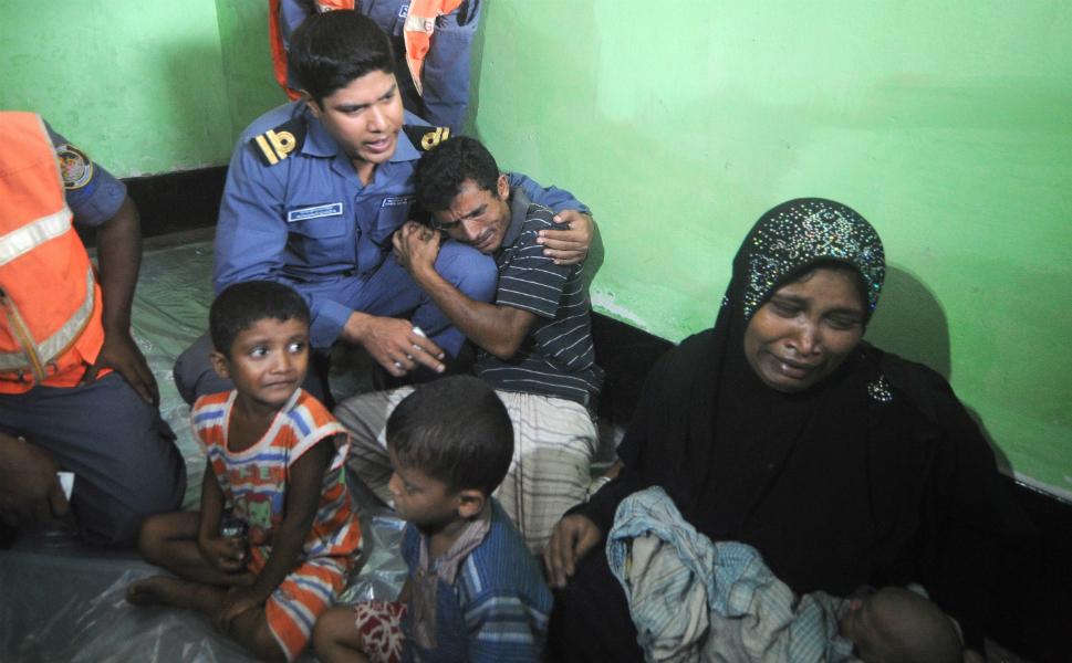 A Rohingya family seeking refuge is overwhelmed at a  Bangladeshi Coast Guard station, before being sent back to Burma.