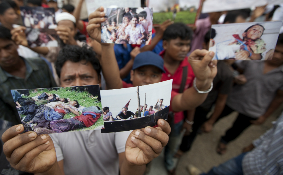 Ethnic Rohingya protest outside a mosque in Kuala Lumpur,  Malaysia, demanding the U.N. intervene and restore peace after deadly clashes.