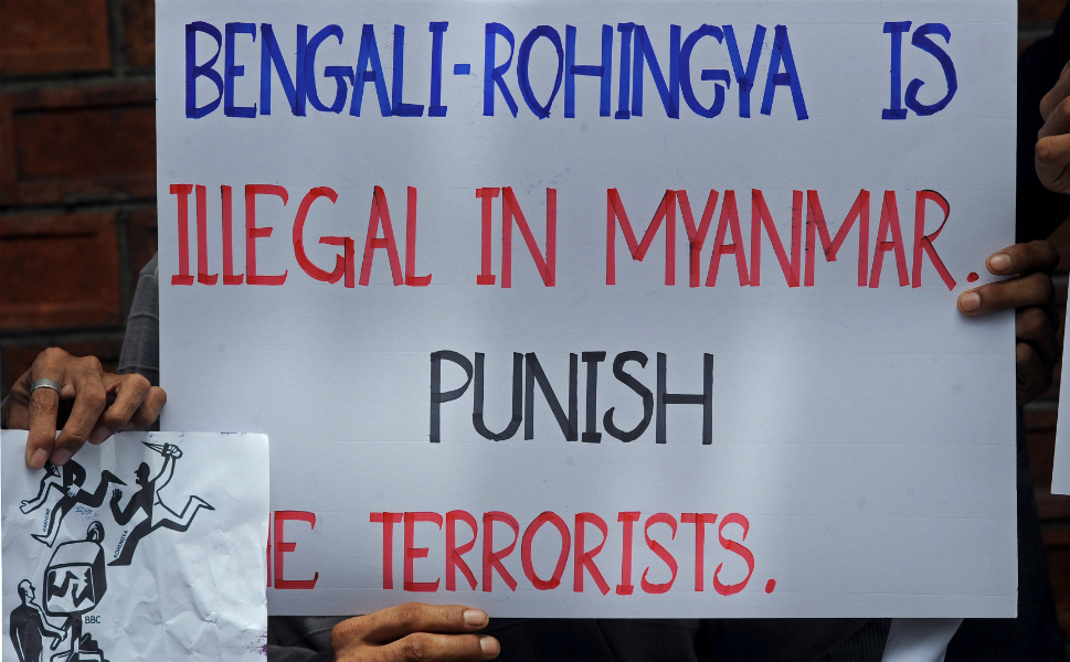 Posters from a demonstration outside the Burmese embassy in  Bangkok, Thailand, demonstrate the discrimination confronting Burma's Rohingya  Muslim population.