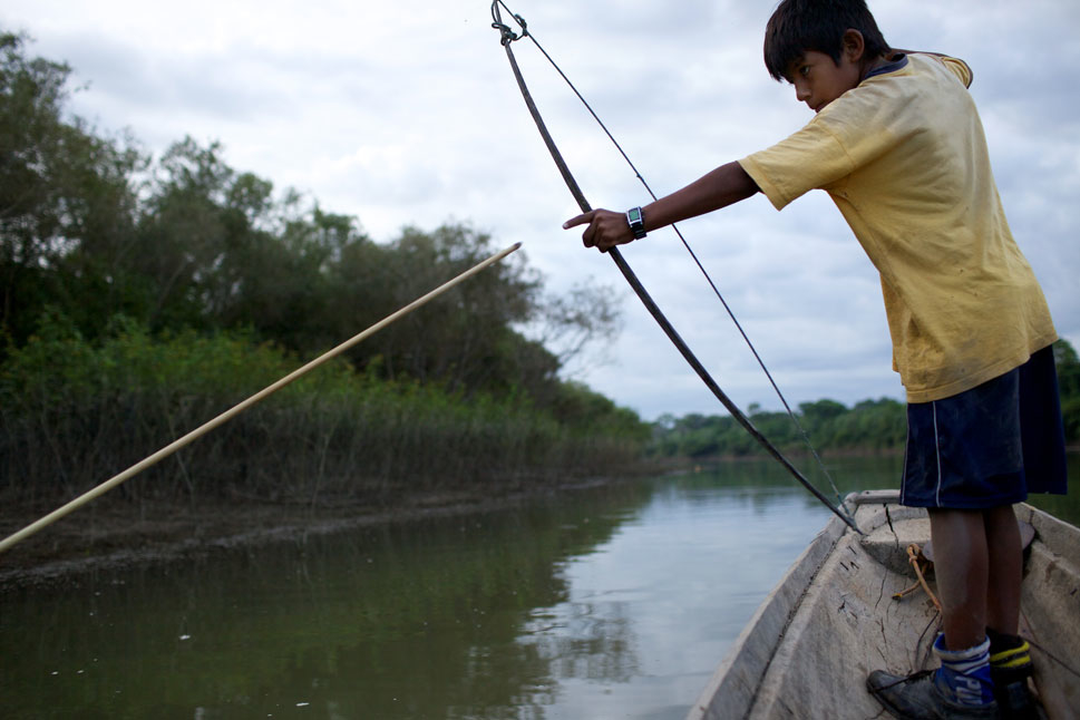 The most controversial IIRSA projects in the region are often funded by Brazil, and many attempt to build in previously undeveloped areas, like a proposed 152-mile highway near the Tipnis National Park in central Bolivia. Above, Juan Gabriel, 11, a Yuracaré boy,  fishes with a bow and arrow in a lagoon off the Isiboro river in Tipnis Park. Yuracaré communities in Bolivia live primarily by  hunting and fishing, and worry that the highway  would bring wholesale  destruction to their lands and way of life.