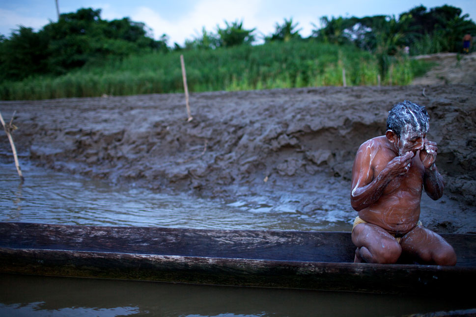The IIRSA project that would bisect the Tipnis National Park is currently one of the most controversial of those proposed. The highway would dramatically change a part of Bolivia that until now has been largely untouched by the outside world. Above, 62 year-old Carmelo Aguilera, a Yuracaré Indian, washes his face. Carmelo has lived his entire life on the edge of the Isiboro river in Tipnis Park. He spends his days chopping firewood, fishing, hunting,  and bathing.