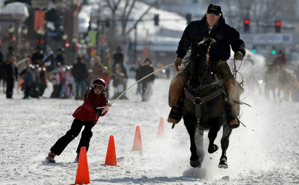 """13.  Skirjoring      In the sport of skijoring, first practiced competitively throughout  Scandinavia, competitors strap on cross-country skis before being tied by an  eight-foot rope to a horse, a vehicle, a team of up to three dogs, or the  occasional mule (winners of this breed get a """"Best Ass in the World"""" trophy at world championship games),  depending on the event.       Racers are  pulled along a 900-foot horseshoe-shaped course complete with jumps and  slalom gates. Some competitions have longer, straighter courses (one Canadian  competition had a 99-mile course) for more of an endurance challenge than a  sprint. Practiced in many countries in Europe and in Canada and the United  States, skijoring world championships are held in Montana each year and include prizes in the tens of thousands of dollars.  Skijoring made it to the Olympic Games only once -- as a demonstration sport in  1928."""