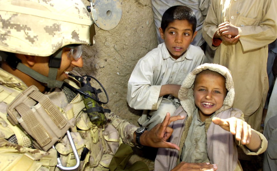 I  didn't like what was being done with that girl and with other children depicted  in the pictures from the 2012 NATO campaign, such as this photograph of a  Canadian officer teaching kids a game in Afghanistan's Kandahar province. I  knew, for example, that we wouldn't use the image of the girl with the U.S.  soldiers in Afghanistan or other Islamic countries to demonstrate our  accomplishments because it displayed the soles of the child's shoes, which, for  those who don't remember President George W. Bush dodging a flying shoe in  Baghdad, is considered an insulting gesture across the Muslim world. So, as a  means of political communications, the image was effectively moot. She made us  feel good, and that was all. And if we weren't thinking through the images we  used to portray our actions, then we probably weren't really thinking about how  we portray children, particularly those in conflict regions.      To  be clear, I don't have anything against photographing children under normal situations or integrating  them into effective political communications, and I admire the heroic and  critical work of combat camera crews. My point is, we need to be much more  careful how and when we use those images so that we don't exploit children.