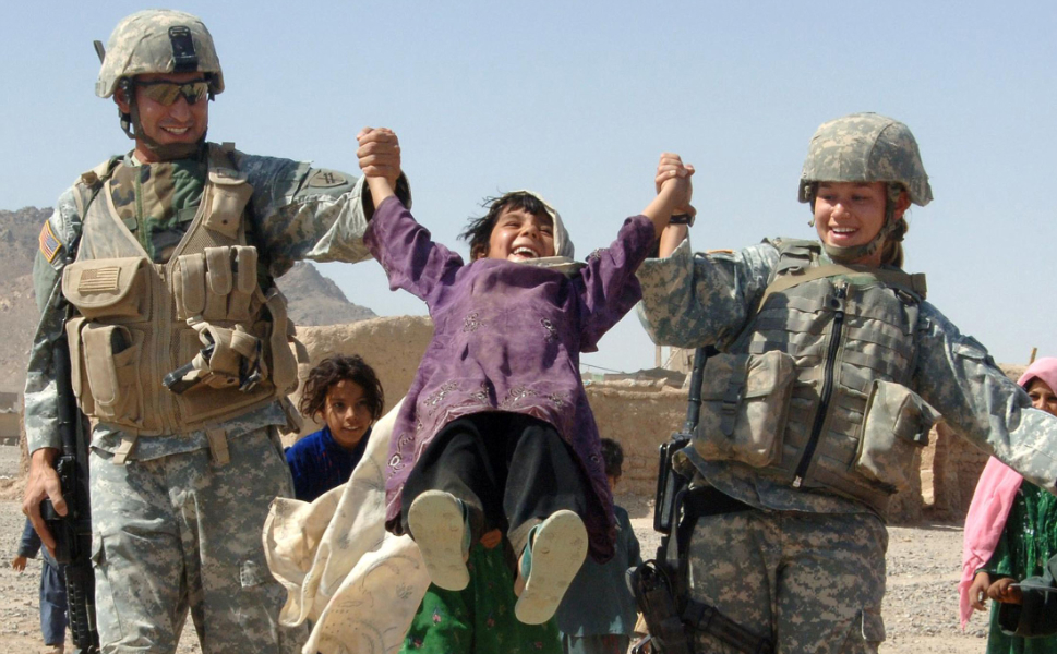 One  image I remember receiving from the U.S. Mission to NATO in Brussels was this  one of American soldiers meeting local children in Farah, Afghanistan. My U.S.  colleagues loved it, and I liked it too. What's not to love? The pure joy of a  child is obvious to anyone. The photograph was displayed outside the offices of the U.S. military delegation in  Brussels with justifiable pride, but  I didn't use it in my campaign. I explained that while it was good optics, it  didn't convey anything real or concrete about the mission in Afghanistan. It  made people feel good, but I needed images that could deliver more.