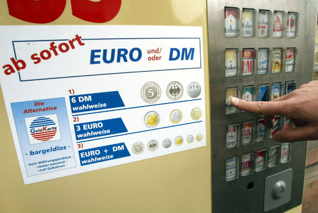 KEHL, GERMANY: Picture taken 28 December 2001 in Kehl of a cigarettes vending machine using deutsche mark and euro coins a few days before the event of the single European currency. AFP PHOTO PIERRE ANDRIEU. (Photo credit should read PIERRE ANDRIEU/AFP/Getty Images)