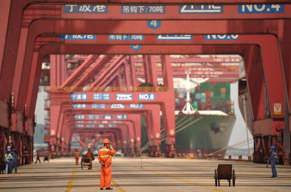 Ningbo: In 2010, China's third-largest port, Ningbo, processed 13  million containers -- about as many as Los Angeles and Long Beach combined. Above, workers prepare to load a waiting container ship at Ningbo Port on June 21, 2012.