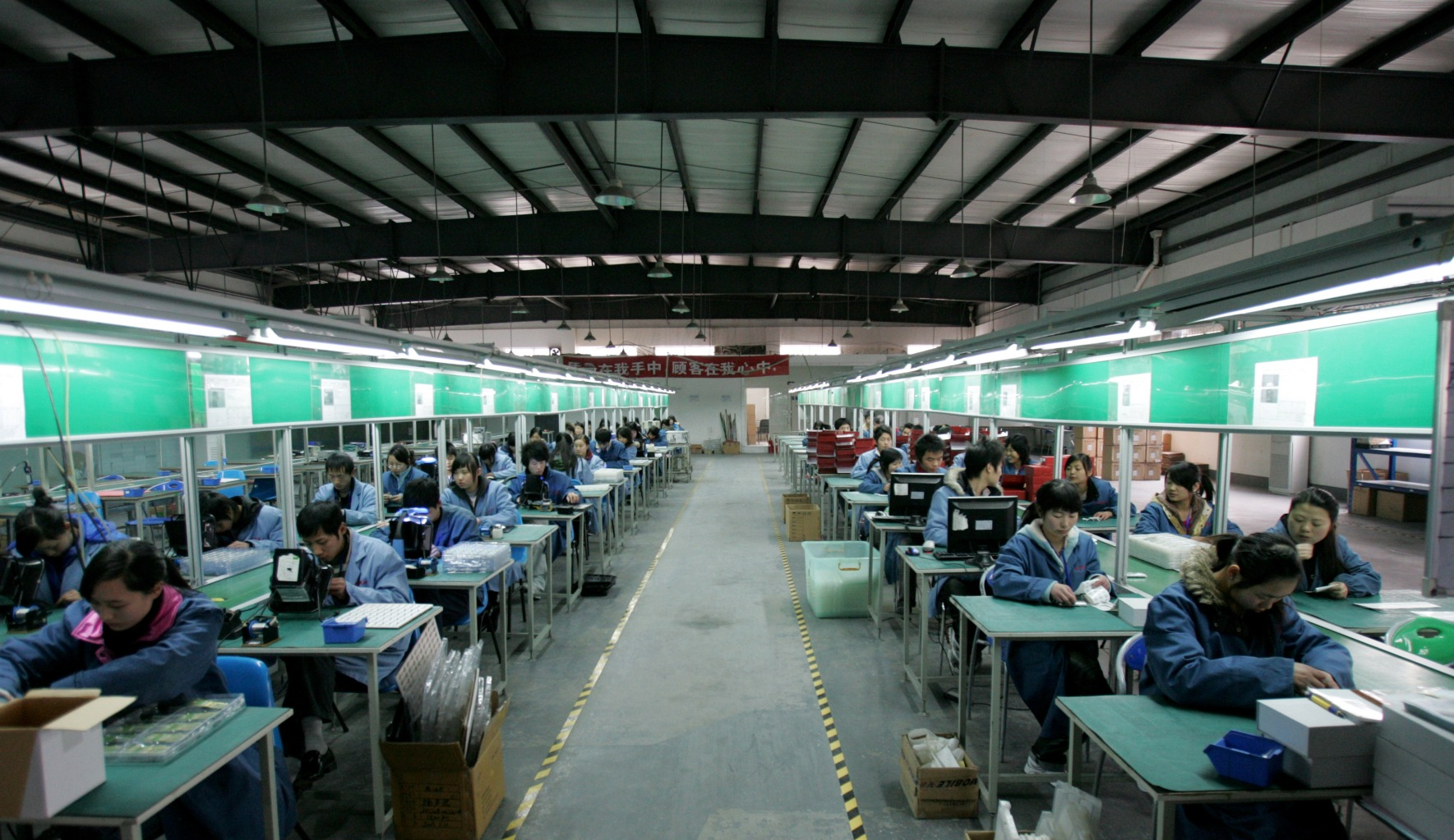 Chengdu: According to China Daily, Chengdu will soon produce 70  percent of Apple's iPads -- some 40 million tablets. Here, Chengdu factory workers labor on a cell-phone production line in February 2009. The global financial crisis threatened China's employment balance as demand for export products dropped, but demand has picked up once again.