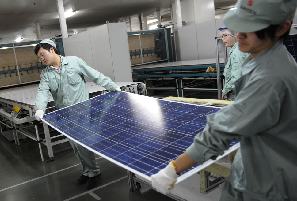 Wuxi: Wuxi hosts Suntech Power, the world's largest manufacturer  of blue solar panels, with annual production capacity of 1,800 megawatts -- enough  to power 360,000 homes. Here, factory workers can be seen assembling solar panels for Suntech on Feb. 27, 2012.