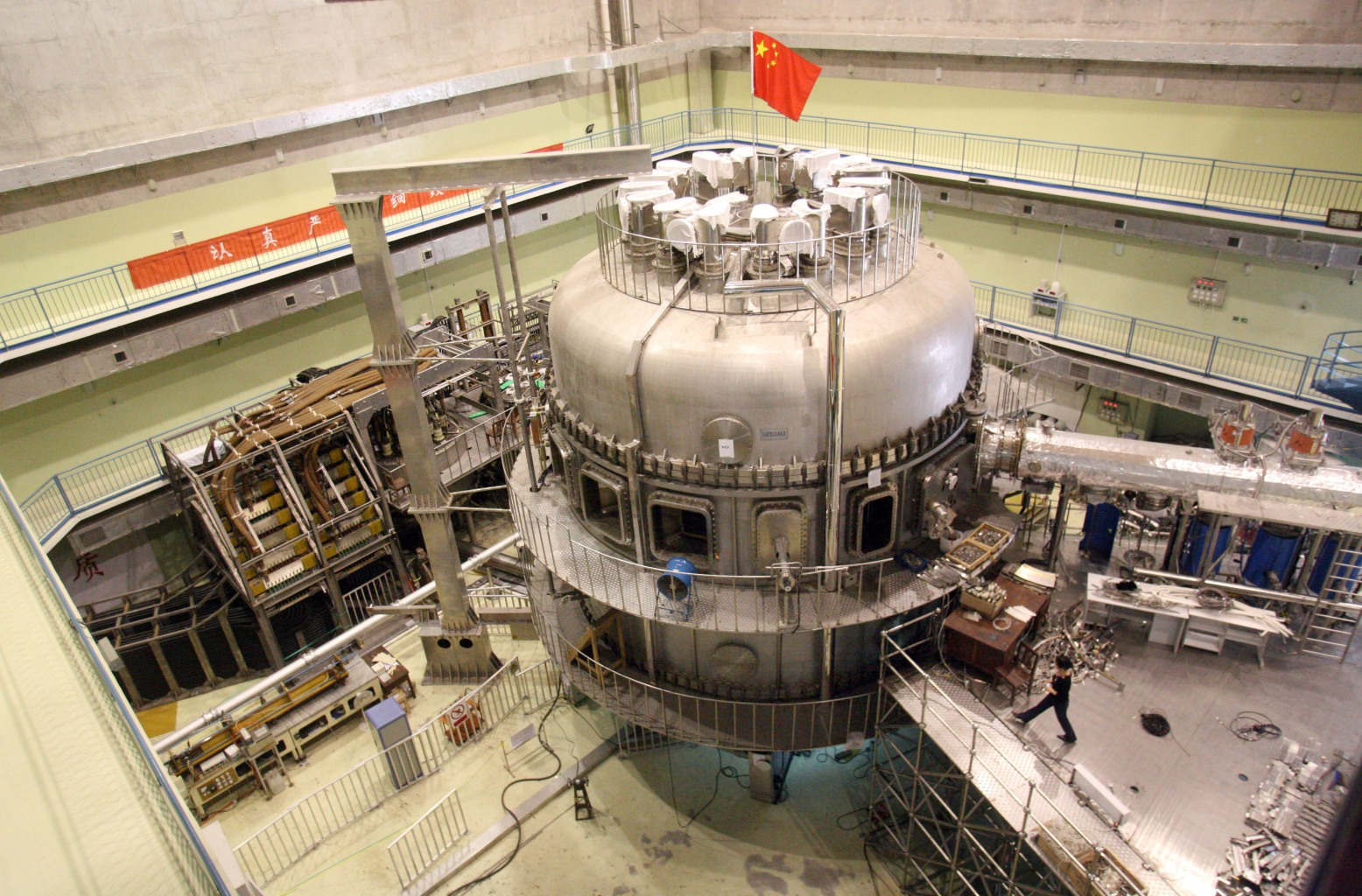 """Hefei: Although Hefei is one of China's lesser known and smaller  cities (by Chinese standards), disposable income growth in the metropolis of  4.9 million is on track to be seven times that of London this year. Above, China's nuclear fusion device is photographed at the Hefei Institute of Physical Science in May 2007. Nicknamed the """"Artificial Sun,"""" the structure is the world's first full superconducting tokamak device and could offer highly effective, safe, and unexhaustable energy in the future."""
